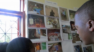 A female participant from Mwanza discussing her photos with a local leader.