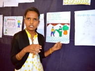 Adolescent girl explains her painting on VAW in Bagalkot