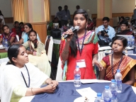 Adolescent girl leaders from Samata programme ask questions of the panellists