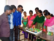 Girls explain their low cost science models to Parivartan male mentors in Bagalkot on IDGC 2014