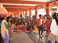 Girls watch a skit on child marriage on the International Day of the Girl Child (IDGC) in Bijapur