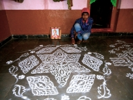 An adolescent boy with a rangoli an art traditionally done by girls in Bijapur