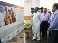 Basavaraj Horatti, Member of Legislative Council and former Minister of Education, Karnataka see the photo exhibition on Samata
