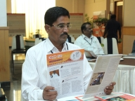 Block Education Officer reading the Samata brochure