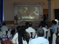 Conference attendees watch the Samata film 'On Our Own Two Feet'
