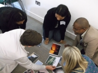 Katherine Fritz, Madhumita Das, Priti Prabhughate, Daniel Nyato and Michelle Moore conducting photo analysis