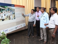 DoE officials learn about Samata's intervention elements and success at the photo exhibition