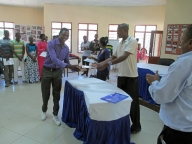 Participants receiving their certificates in Mwanza.