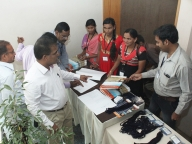 Sarojini and Kumar of KHPT along with adolescent girls from Samata manage the registration