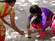 Girls playing Lagori, a traditional game in Karnataka